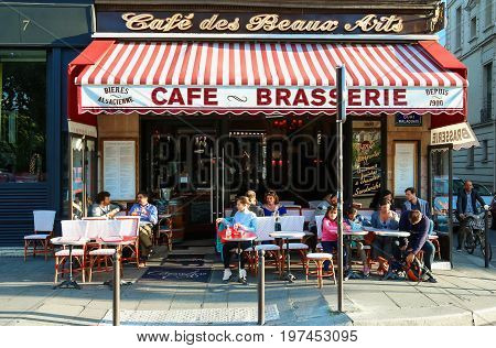 PARIS, FRANCE - JULY 25, 2017 : The Cafe des Beaux Arts is named this due to its location right by the School of Fine Arts, and has a typical Parisian brasserie style decor of wood and deep reds.
