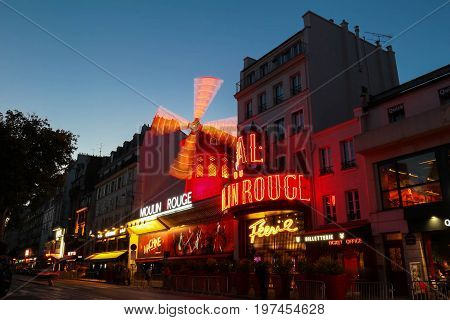 Paris, France-JULY 25, 2017: The Moulin Rouge night lights in Paris, France. Moulin Rouge is a famous cabaret built in 1889, locating in the Paris red-light district of Pigalle.