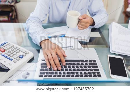 Business Man Holding Coffee Cup During Working At Home Office