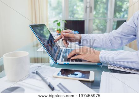 Business Man Working On Open Laptop At Home Office