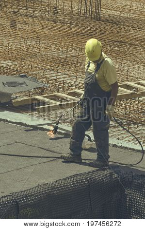 Insulation Worker With Blowtorch 6