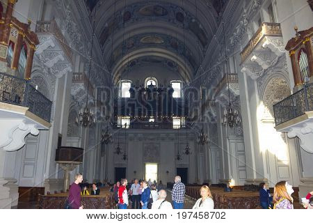 Salzburg, Austria - May 01, 2017: People going to Salzburg Cathedral - details on May 01, 2017 in Salzburg, Austria