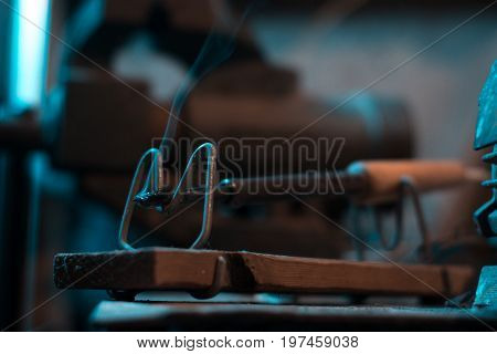 Old soldering iron in instrumental with blurred background