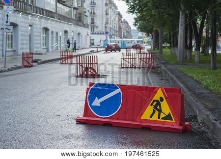 wet road traffic sign detour on the street