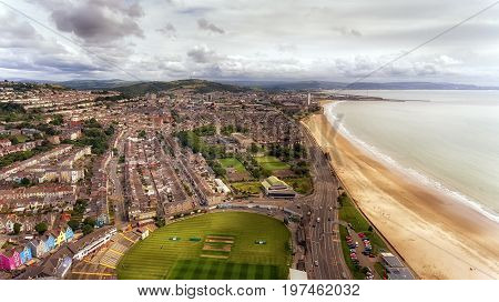 Editorial Swansea, UK - July 29, 2017: A view of Swansea City from 'The Rec' showing St Helen's Rugby and Cricket Ground, The Patti Pavilion, Victoria Park, Guild Hall and Mumbles Road
