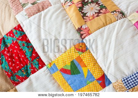 decoration, creation, art concept. bright eye-catching blanket made in patchwork teqnicue owerhelmed by colors, images of gerberas and arctotis concluded in bizarre pattern