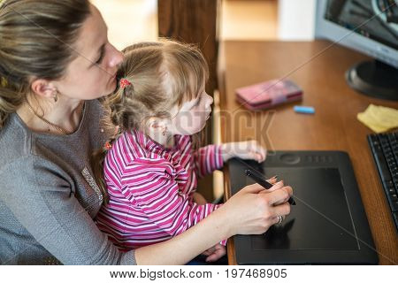 People, Family, Home Education, Children And Technology Concept - Happy Mother And Daughter With Tab