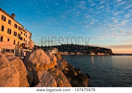 Colorful architecture at sunset, bay of Piran, small coastal town in Istria, Slovenia