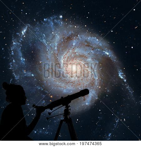 Girl Looking At The Stars With Telescope. Pinwheel Galaxy Messie