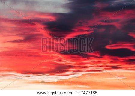 colorful fiery sky abstract at sunset with altocumulus clouds