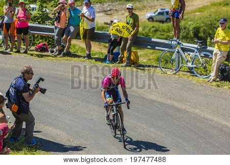 Col du Grand ColombierFrance - July 17 2016: The Slovenian cyclist Jan Polanc of Lampre-MeridaTeam riding on the road to Col du Grand Colombier in Jura Mountains during the stage 15 of Tour de France 2016.
