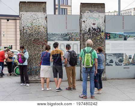 BERLIN GERMANY - JUNE 26 2017: Tourists Looking At A Part of The Former Berlin Wall At Potsdamer Platz In Berlin