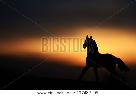 Silhouette of a horse against a beautiful sunset
