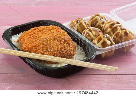 fried pork topped on rice (tonkatsu) and Tako Yaki on Box Japanese food