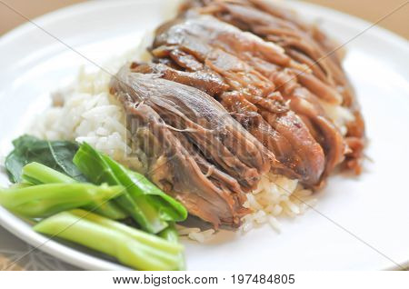 fresh ham on rice rice topped with stew pork or stewed pork