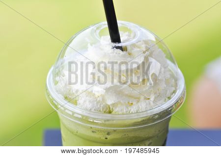 green tea frappe with whipped cream topping or green tea frappuccino