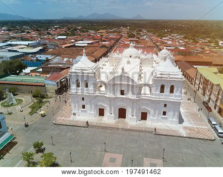 White church in Leon on volcano background aerial drone view