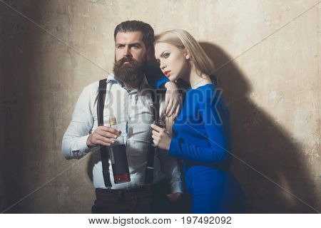 Girl And Man Posing With Bottle And Glass Of Liqueur