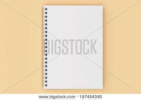 Closed Notebook Spiral Bound On Orange Background