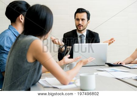 Business negotiation male partners arguing funny easygoing woman keeping calm in stressing situation meditating with composed smile dealing with emotional angry customer stress management concept