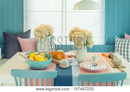 Wooden table and chair in vintage dinning room at home. Table set on dining table interior design.