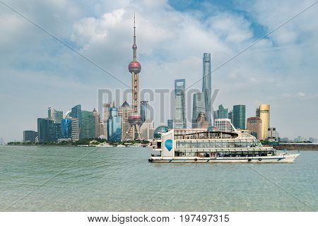 Shanghai lujiazui finance and business district trade zone skyline with cruise ship Shanghai China