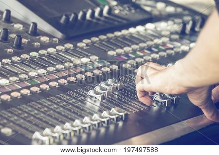 Fingers Move The Sliders On The Big Sound Mixer 2