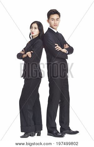 studio portrait of asian business corporate man and woman in formal wear looking serious isolated on white background.