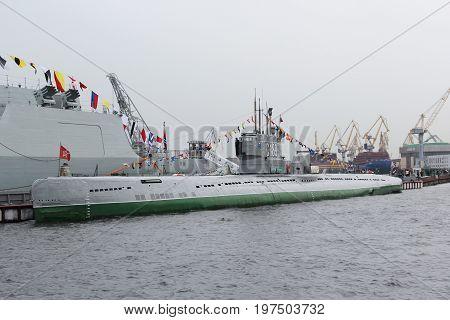 Saint-Petersburg, Russia - Jul 29 2017: Museum Of Submarine S-189 project 613 on the background of port cranes. Summer. Rain. The Lieutenant Schmidt embankment of Vasilevsky Island. 1954 built.