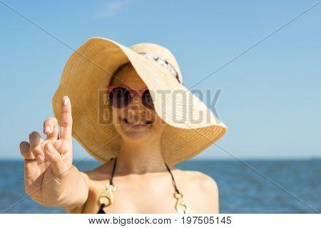 suntan lotion woman applying sunscreen solar cream. Beautiful happy cute woman applying suntan cream. Sunscreen on the finger.
