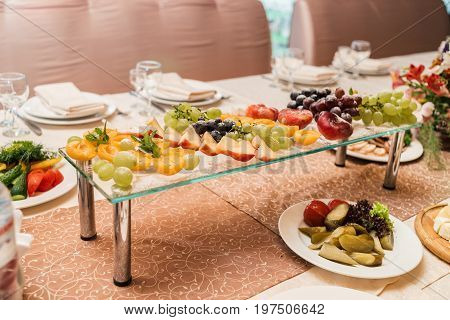 Fresh Grapes, Nectarine, Peach And Apricot With Sugar Powder On Glass Stand, Selective Focus. Fruit
