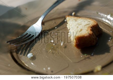 Remains Of Bread On Plate