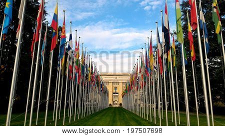 GENEVA, SWITZERLAND - October 11, 2015: National flags at the entrance in UN office at Geneva, Switzerland . The United Nations was established in Geneva in 1947 and is the second largest UN office.