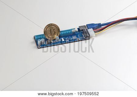 Bitcoin coin on PCIe riser for mining