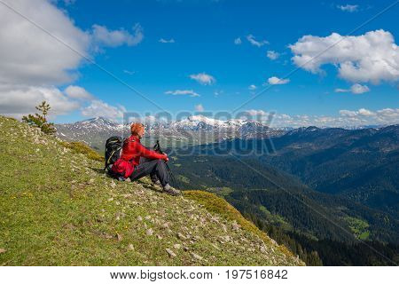 Traveler Relaxing And Meditation In Mountains