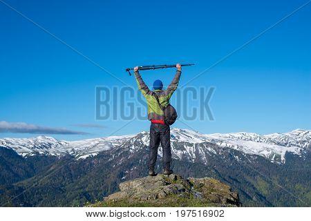 Traveler Photographer Stands On A Rock
