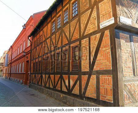 Impressive bricked half-timbered houses at the Lilla torg or Little square of Malmo, Sweden