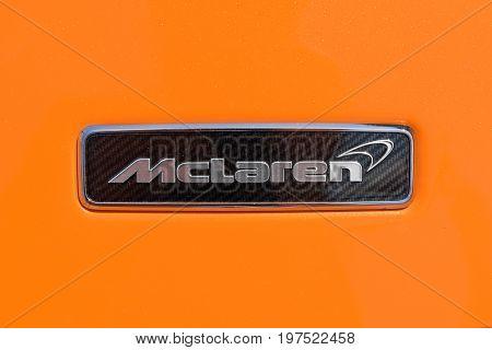 TURIN, ITALY - JUNE 10, 2017: McLaren logo on a orange body car