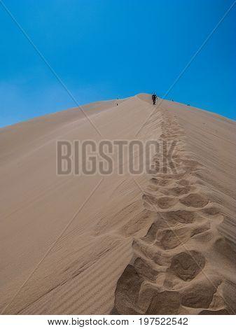 Huacachina dune rise foot prints detail Peru