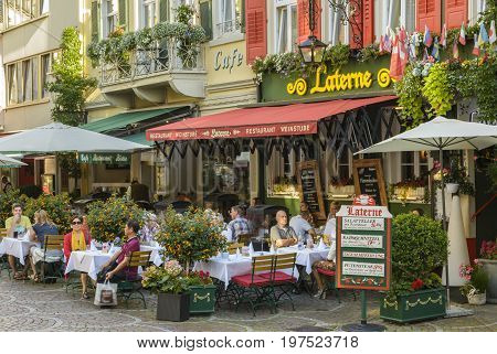 Historic center with Shopping street and Pedestrian zone with many restaurants and terraces full with tourists on July 29 2017 in Baden Baden Baden-Wurttemberg Germany.