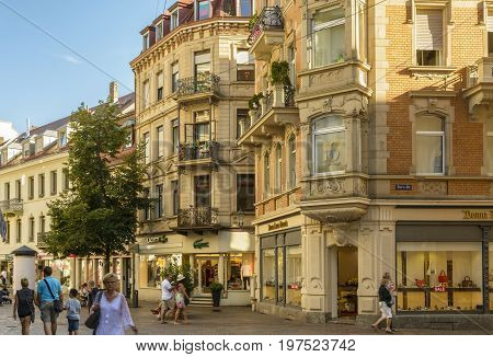 Historic center with Shopping street and Pedestrian zone with many restaurants and terraces full with tourists on July 29 2017 in Baden Baden Baden-Württemberg Germany.