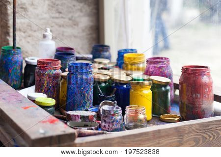 Color Jars And Tempera On Working Table In Ceramic Lab In Turkey