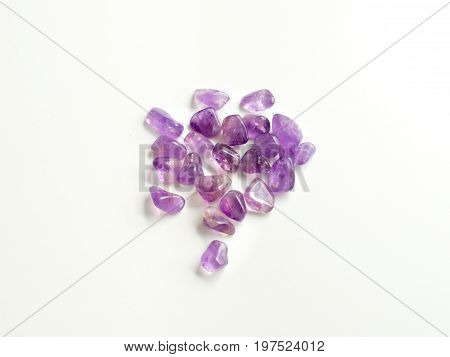 Tumbled Amethyst Stones Close Up From Top For Crystal Therapy Treatments And Reiki