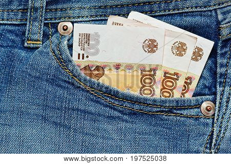 Financial crisis concept - only a few russian rubles in front jeans pants pocket