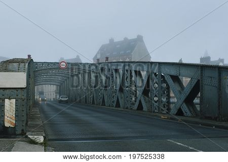 Cars Passing On The Asphalt Road Through The City Bridge Tunnel On A Foggy Day In Dieppe, France. Ur