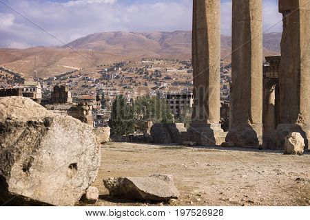 Ruins of Jupiter temple with columns and mountain range in Baalbek, Bekaa valley Lebanon