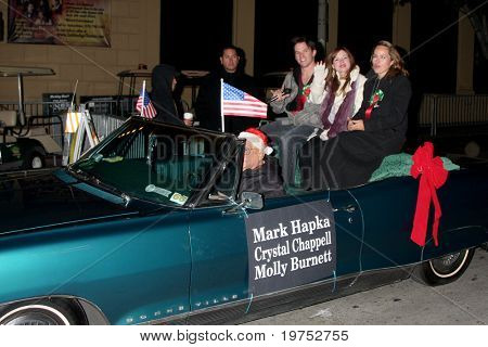 LOS ANGELES - NOV 28:  Mark Hapka, Moly Burnett, Chrystal Chappell arrive at the 2010 Hollywood Christmas Parade at Hollywood Boulevard on November 28, 2010 in Los Angeles, CA
