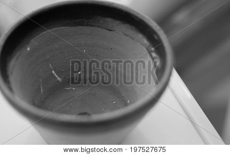 BLACK AND WHITE PHOTO OF CLOSE-UP OF CLAY POT TEXTURE