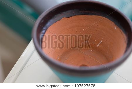 COLOR PHOTO OF CLOSE-UP OF CLAY POT TEXTURE