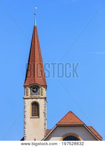 Clock tower of the protestant church in the town of Wallisellen in the Swiss canton of Zurich.